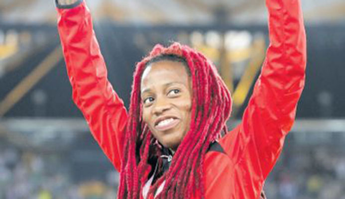 T&T Michelle-Lee Ahye acknowledges the crowd during her medal ceremony at the Gold Coast 2018 XXI Commonwealth Games at Carrara Stadium, Gold Coast, Australia, last week. PICTURE CA-IMAGES/ALLAN CRANE