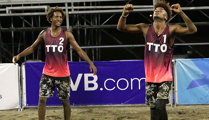 T&T's Daynte Stewart (#1) and Marlon Phillip (#2) celebrate their quarterfinal win over Dominican Republic's Victor Castillo and Alexi Medina during the third leg of the 2019 NORCECA Beach Volleyball Tour in Managua, Nicaragua on Saturday night. The T&T men won 21-12, 18-21, 15-8. Photo: NORCECA