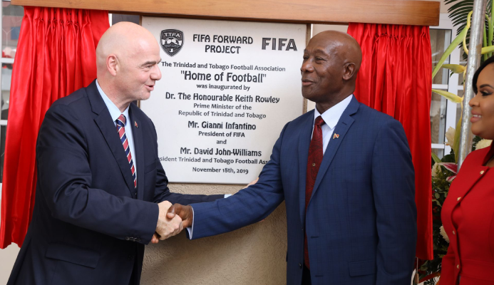 Prime Minister Dr Keith Rowley, right, shakes hands with FIFA president Gianni Infantino after unveiling the plaque during the opening ceremony for the Home of Football in Balmain, Couva, yesterday.  RISHI RAFGOONATH
