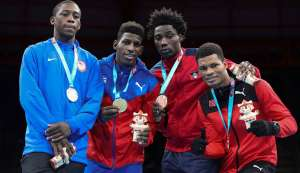 Silver medallist Keyshawn Davis of the United States, left, champion Andy Cruz of Cuba, centre, and bronze medallists Alston Ryan of Antingua and Barbuda, second right, and Michael Alexander of TT in the men's light welterweight boxing at the Pan American Games in Lima, Peru, earlier this month.