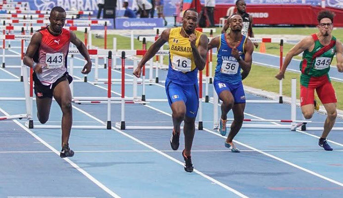 Bajan Shane Brathwaite, second from lleft, takes gold in the CAC 110m hurdles yesterday ahead of TT's Ruebin Walters, left, in Colombia.
